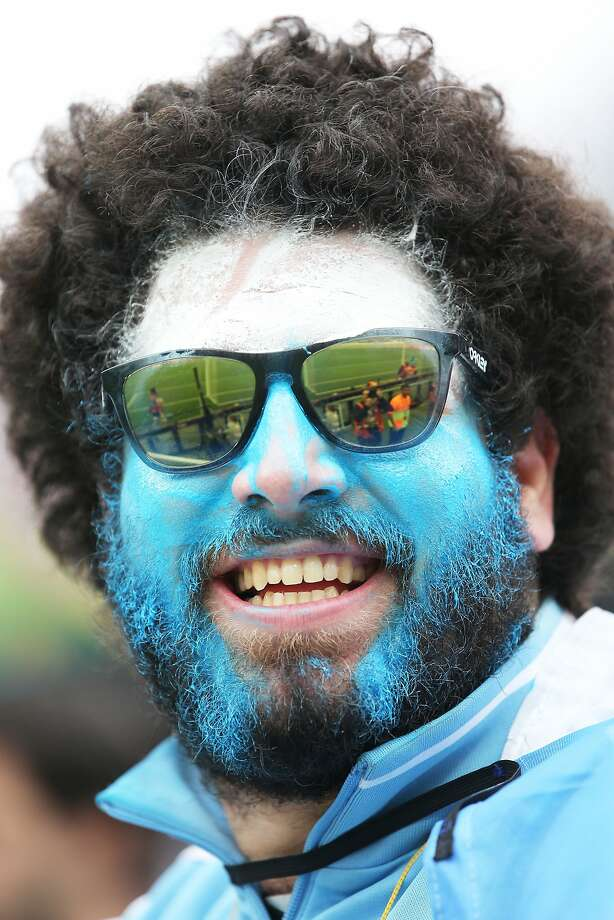 An Argentina fan enjoys the atmosphere prior to the 2014 FIFA World Cup Brazil Semi Final match between the Netherlands and Argentina at Arena de Sao Paulo on July 9, 2014 in Sao Paulo, Brazil.  Photo: Dean Mouhtaropoulos, Getty Images