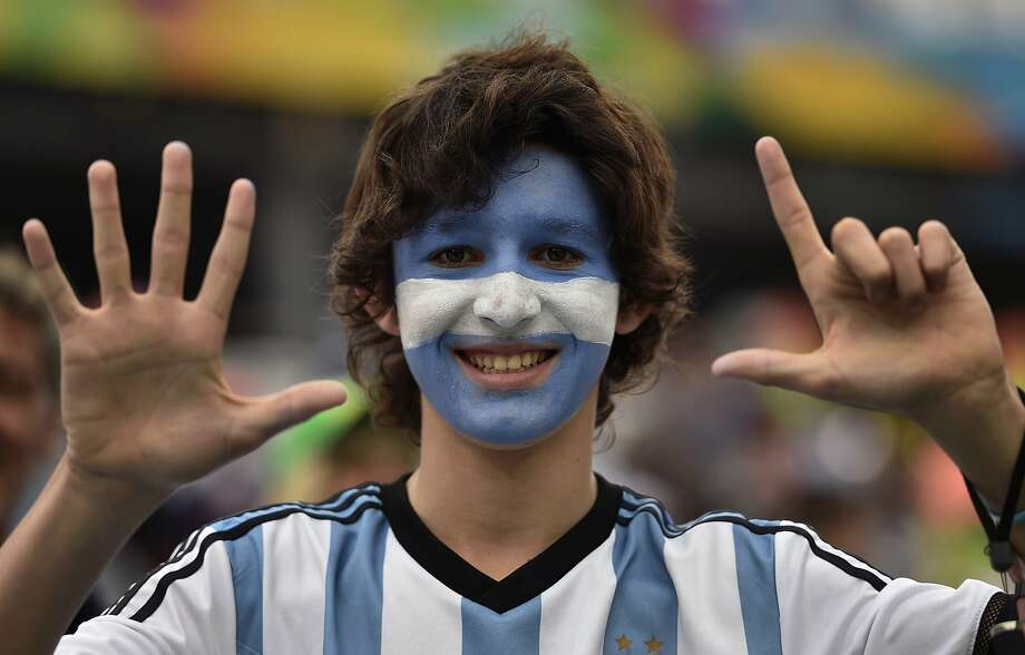 An Argentina supporter gestures, referring to the seven goals that Brazil conceded in Tuesday's semifinal with Germany, before the World Cup semifinal soccer match between the Netherlands and Argentina at the Itaquerao Stadium in Sao Paulo Brazil, Wednesday, July 9, 2014.  Photo: Martin Meissner, Associated Press
