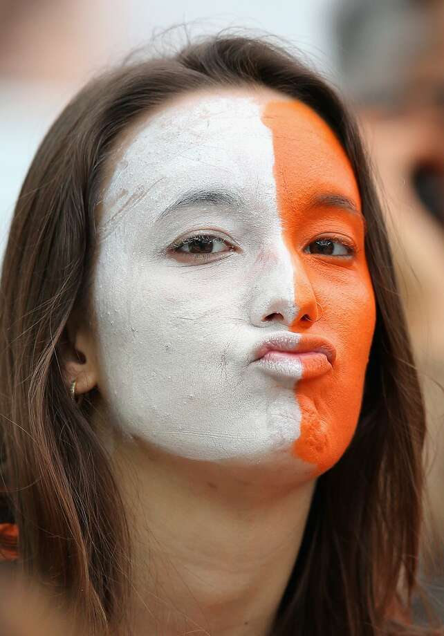 A Netherlands fan enjoys the atmosphere prior to the 2014 FIFA World Cup Brazil Semi Final match between the Netherlands and Argentina at Arena de Sao Paulo on July 9, 2014 in Sao Paulo, Brazil.  Photo: Dean Mouhtaropoulos, Getty Images