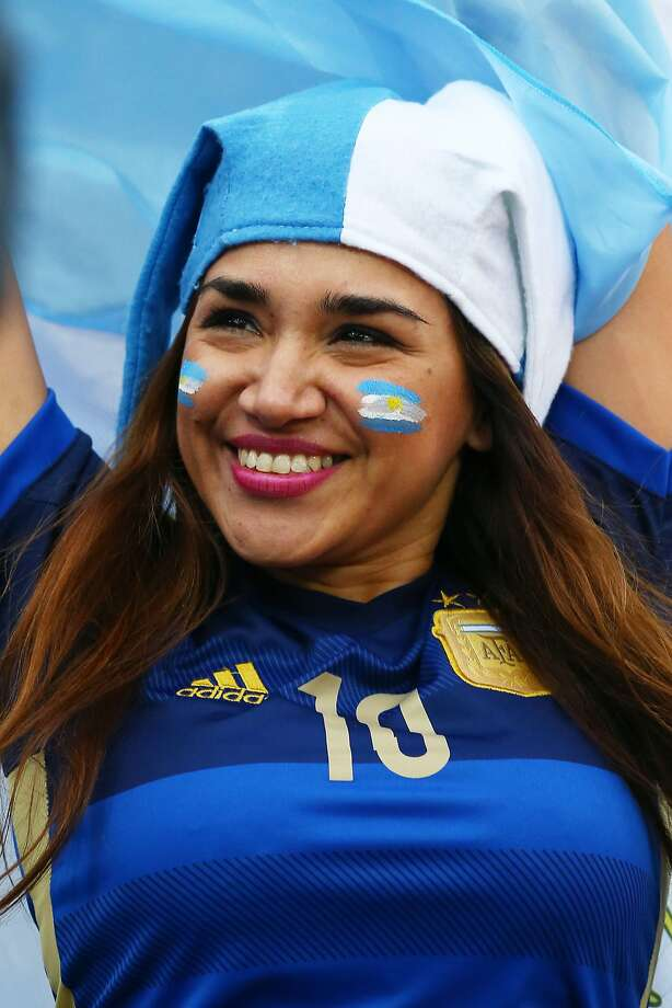 An Argentina fan enjoys the atmosphere prior to the 2014 FIFA World Cup Brazil Semi Final match between the Netherlands and Argentina at Arena de Sao Paulo on July 9, 2014 in Sao Paulo, Brazil.  Photo: Ronald Martinez, Getty Images