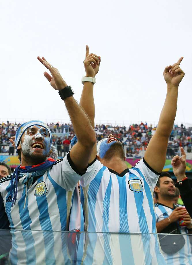 Argentina fans enjoy the atmosphere prior to the 2014 FIFA World Cup Brazil Semi Final match between the Netherlands and Argentina at Arena de Sao Paulo on July 9, 2014 in Sao Paulo, Brazil. Photo: Ronald Martinez, Getty Images