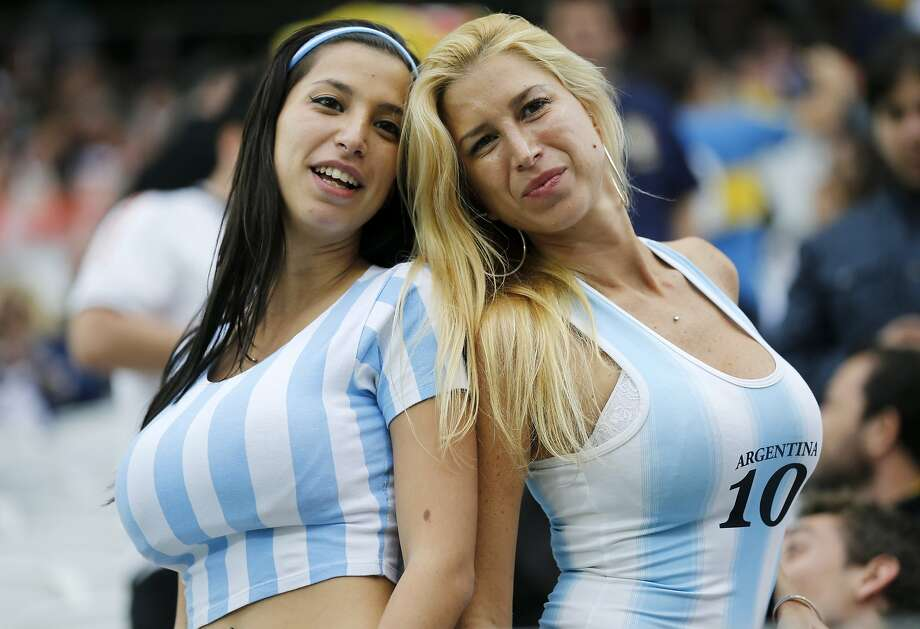 Argentina supporters pose for a photograph prior to the World Cup semifinal soccer match between the Netherlands and Argentina at the Itaquerao Stadium in Sao Paulo, Brazil, Wednesday, July 9, 2014. Photo: Frank Augstein, Associated Press