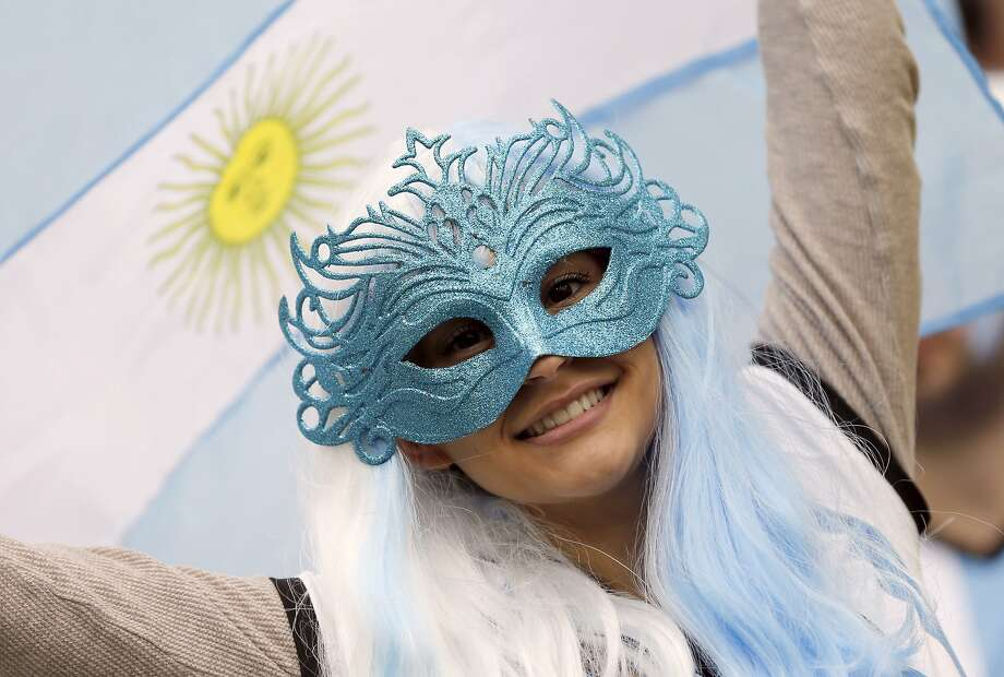 An Argentina supporter smiles prior to the World Cup semifinal soccer match between the Netherlands and Argentina at the Itaquerao Stadium in Sao Paulo Brazil, Wednesday, July 9, 2014. Photo: Frank Augstein, Associated Press