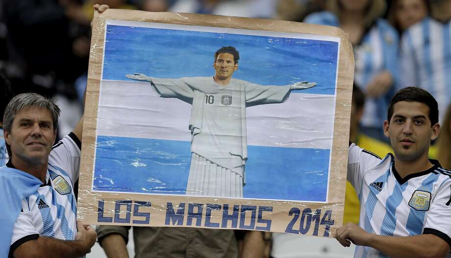 Argentine supporters hold a poster of Argentina's Lionel Messi made to resemble the Christ the Redeemer statue before the World Cup semifinal soccer match between the Netherlands and Argentina at the Itaquerao Stadium in Sao Paulo Brazil, Wednesday, July 9, 2014.  Photo: Natacha Pisarenko, Associated Press