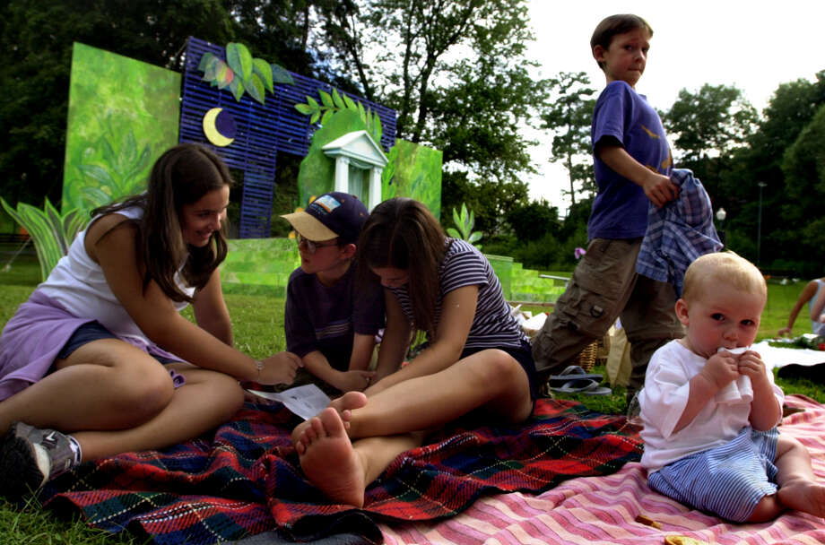 Times Union staff photo by Cindy Schultz -- Family and friends gather before the start of  William Shakespeare's 'A Midsummer Night's Dream' Wednesday, July 25, 2001, at Congress Park in Saratoga Springs, N.Y. From left are Katrina Dumas, 13, James Hodge, 10, Emily Hodge, 13, Peter Hodge, 7, and Sam Havens, 9 months. (SECONDARY PHOTO FOR STANDALONE PKG.) Photo: CINDY SCHULTZ / ALBANY TIMES UNION
