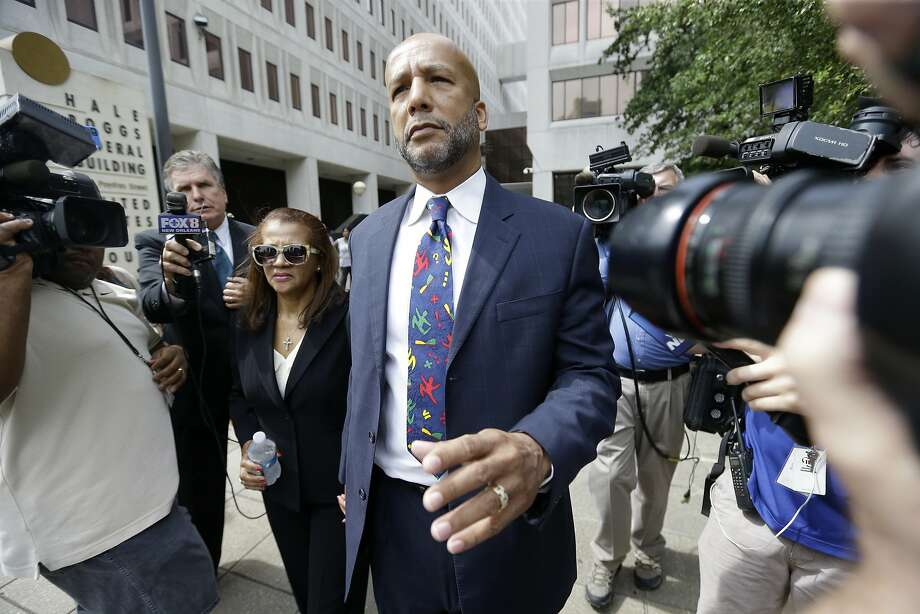 Former New Orleans Mayor Ray Nagin leaves federal court with his wife Seletha Nagin after being sentenced in New Orleans, Wednesday, July 9, 2014.  Nagin was sentenced Wednesday to 10 years in prison for bribery, money laundering and other corruption that spanned his two terms as mayor, including the chaotic years after Hurricane Katrina hit in 2005. He was convicted Feb. 12 of accepting hundreds of thousands of dollars from businessmen who wanted work from the city or Nagin's support for various projects. The bribes came in the form of money, free vacations and truckloads of free granite for his family business. (AP Photo/Gerald Herbert) Photo: Gerald Herbert, Associated Press