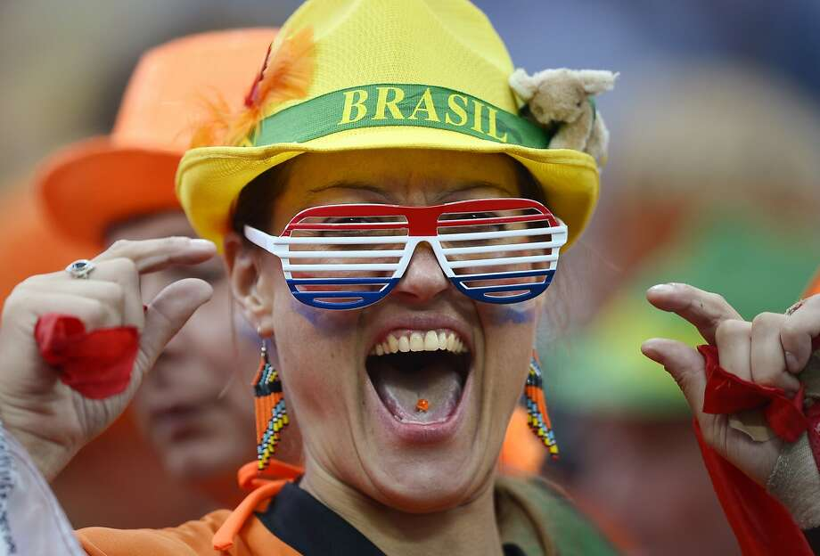 A Dutch supporter reacts before the World Cup semifinal soccer match between the Netherlands and Argentina at the Itaquerao Stadium in Sao Paulo Brazil, Wednesday, July 9, 2014.  Photo: Manu Fernandez, Associated Press