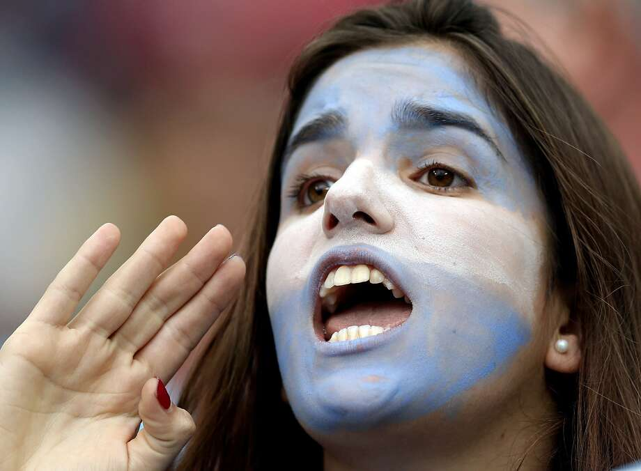 An Argentine supporter cheers for her national team before the World Cup semifinal soccer match between the Netherlands and Argentina at the Itaquerao Stadium in Sao Paulo Brazil, Wednesday, July 9, 2014. Photo: Victor R. Caivano, Associated Press