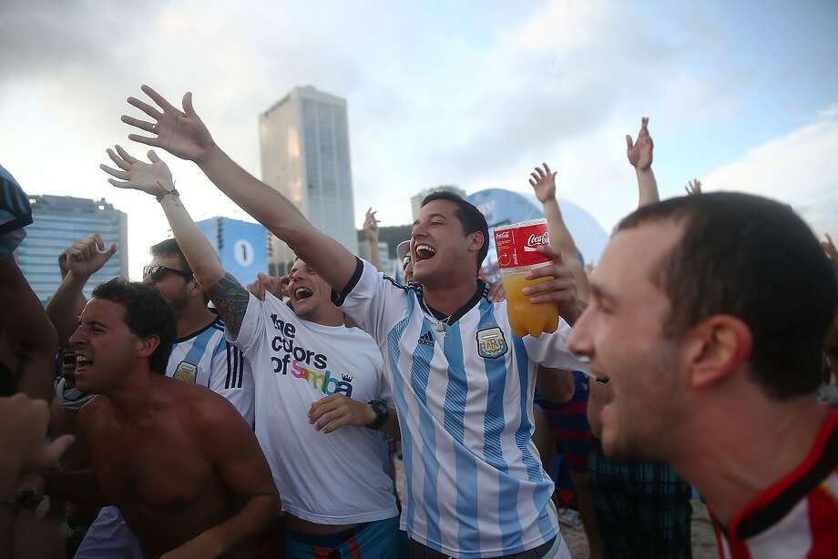 Argentina fans gather on Copacabana Beach before the start of their match against the Netherlands in the 2014 FIFA World Cup on July 9, 2014 in Rio de Janeiro, Brazil. The winner advances to the final match at Maracana. Photo: Mario Tama, Getty Images