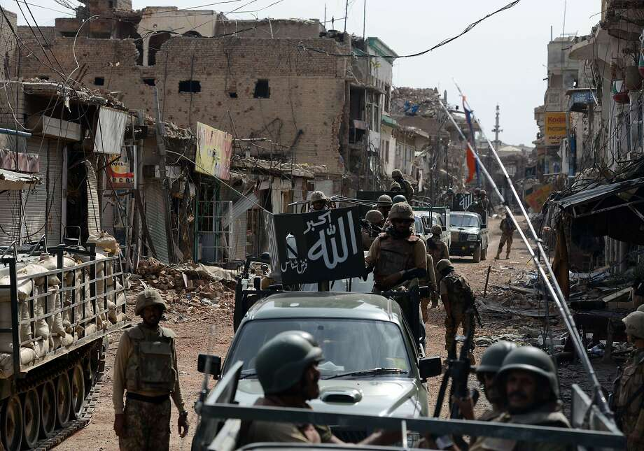 Pakistani soldiers patrol at a destroyed empty bazaar during a military operation against Taliban militants in the main town of Miranshah in North Waziristan on July 9, 2014. Last month Pakistan's military launched a long-awaited offensive in North Waziristan, aimed at wiping out longstanding militant strongholds in the area, which borders Afghanistan. More than 800,000 people have fled a major military offensive against the Taliban in a Pakistani tribal area, officials said on July 9. AFP PHOTO/Aamir QURESHIAAMIR QURESHI/AFP/Getty Images Photo: Aamir Qureshi, AFP/Getty Images