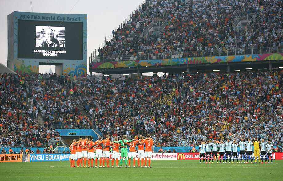 The Netherlands and Argentina observe a moment of silence for Alfredo Di Stefano during the 2014 FIFA World Cup Brazil Semi Final match between the Netherlands and Argentina at Arena de Sao Paulo on July 9, 2014 in Sao Paulo, Brazil.  Photo: Dean Mouhtaropoulos, Getty Images