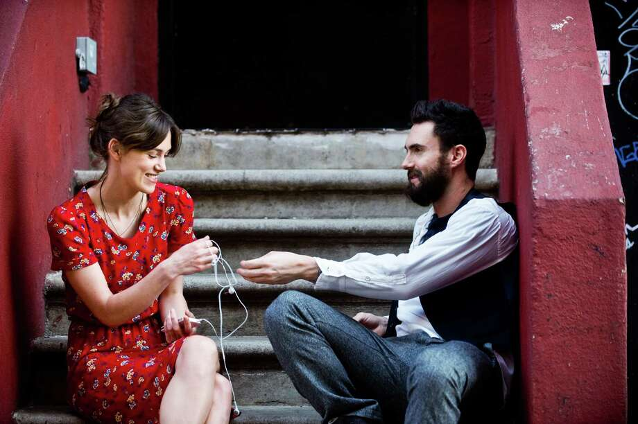 "This image released by The Weinstein Company shows Keira Knightley, left, and Adam Levine in a scene from ""Begin Again."" Levine says his acting debut in the film ""Begin Again"" has inspired him to continue acting. The part, playing a young musician who strikes it big, was easy to identify with for the pop star. (AP Photo/The Weinstein Company, Andrew Schwartz) ORG XMIT: NYET306 Photo: Andrew Schwartz / The Weinstein Company"