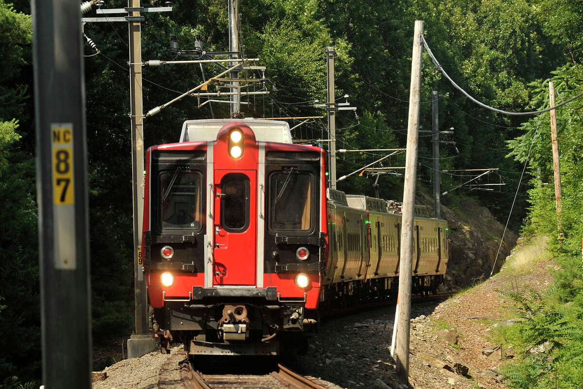 A Metro-North train travels south between the Talmadge Hill station and the Hoyt Street crossing in Darien, Conn., on Wednesday, July 9, 2014.