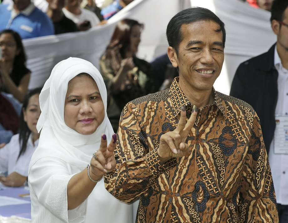 Surveys show Joko Widodo winning the presidential election. Photo: Dita Alangkara, Associated Press