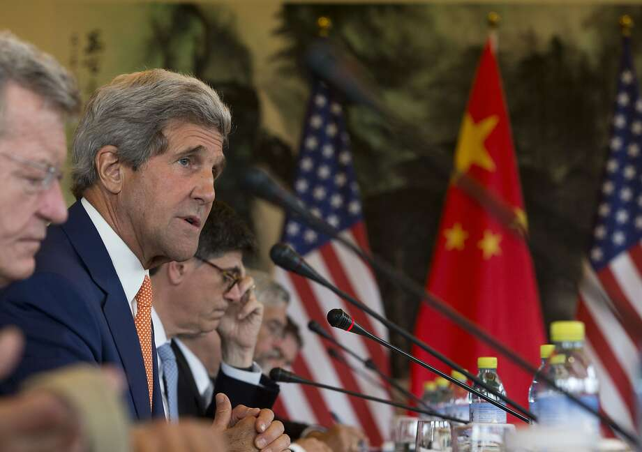 Secretary of State John Kerry speaks at a conference on climate change with Chinese officials in Beijing. Environmental activists complain that both countries have failed to take adequate steps to curb emissions. Photo: Pool, Getty Images