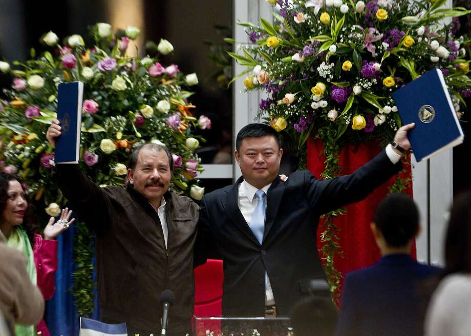 President Daniel Ortega (left) and Chinese businessman Wang Jing sign a deal in Managua last year for the construction of a multibillion-dollar canal. Photo: Esteban Felix, Associated Press