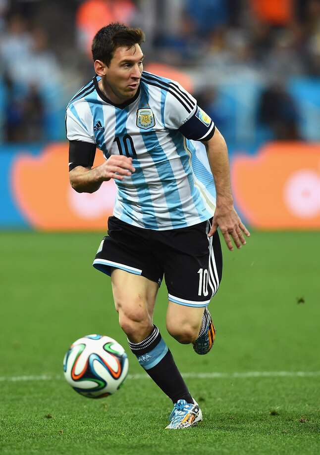 Lionel Messi of Argentina controls the ball during the 2014 FIFA World Cup Brazil Semi Final match between the Netherlands and Argentina at Arena de Sao Paulo on July 9, 2014 in Sao Paulo, Brazil.  Photo: Matthias Hangst, Getty Images