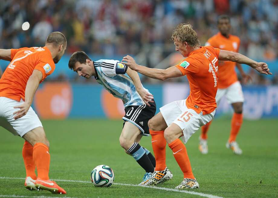 Lionel Messi of Argentina is challenged by Dirk Kuyt of the Netherlands during the 2014 FIFA World Cup Brazil Semi Final match between the Netherlands and Argentina at Arena de Sao Paulo on July 9, 2014 in Sao Paulo, Brazil. Photo: Dean Mouhtaropoulos, Getty Images