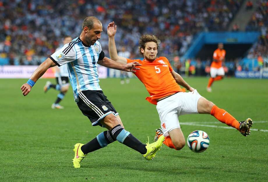 Pablo Zabaleta of Argentina is challenged by Daley Blind of the Netherlands during the 2014 FIFA World Cup Brazil Semi Final match between the Netherlands and Argentina at Arena de Sao Paulo on July 9, 2014 in Sao Paulo, Brazil.  Photo: Jamie Squire, Getty Images