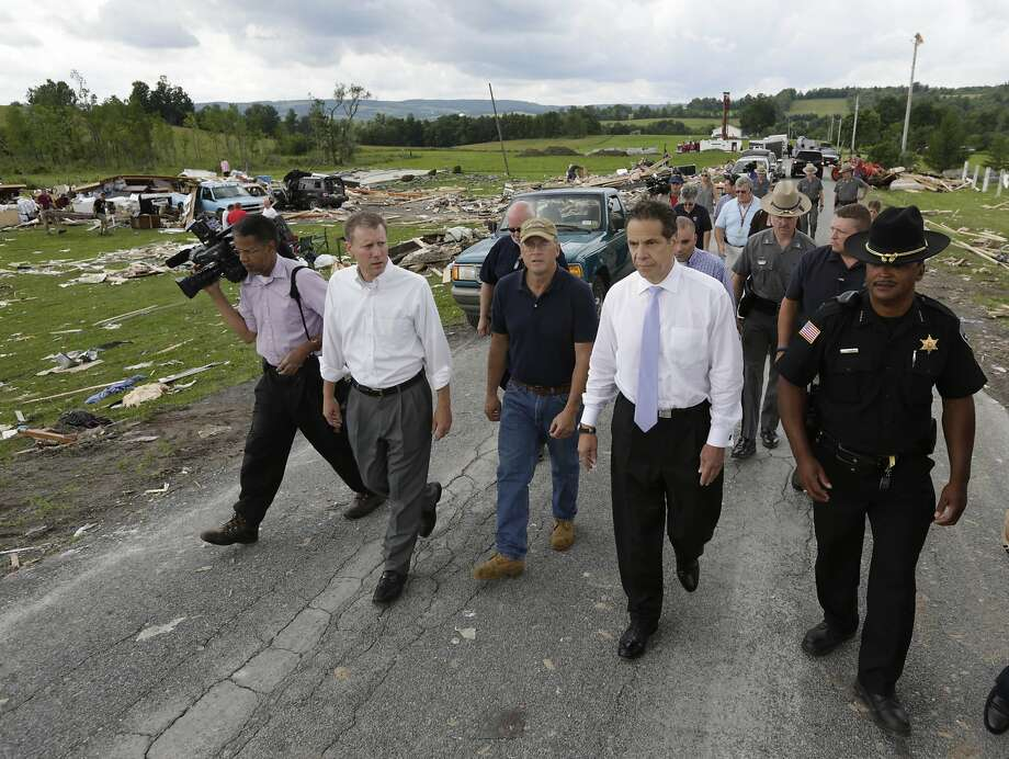 State Sen. David Valesky (left), Smithfield Town Supervisor Rick Bargabos, Gov. Andrew Cuomo and Madison County Sheriff Allen Riley survey the damage from Tuesday night's tornado in Smithfield, N.Y. Photo: Mike Groll, Associated Press