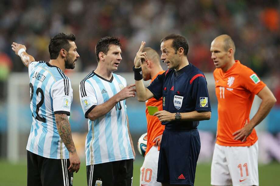 Ezequiel Lavezzi (L) and Lionel Messi of Argentina react toward referee Cuneyt Cakir during the 2014 FIFA World Cup Brazil Semi Final match between the Netherlands and Argentina at Arena de Sao Paulo on July 9, 2014 in Sao Paulo, Brazil. Photo: Dean Mouhtaropoulos, Getty Images
