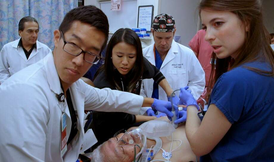 "A medical team attends to a patient at the Los Angeles County Medical Center emergency room, which the documentary ""Code Black"" portrays as a microcosm for an overwhelmed American health system. Photo: Long Shot Factory"