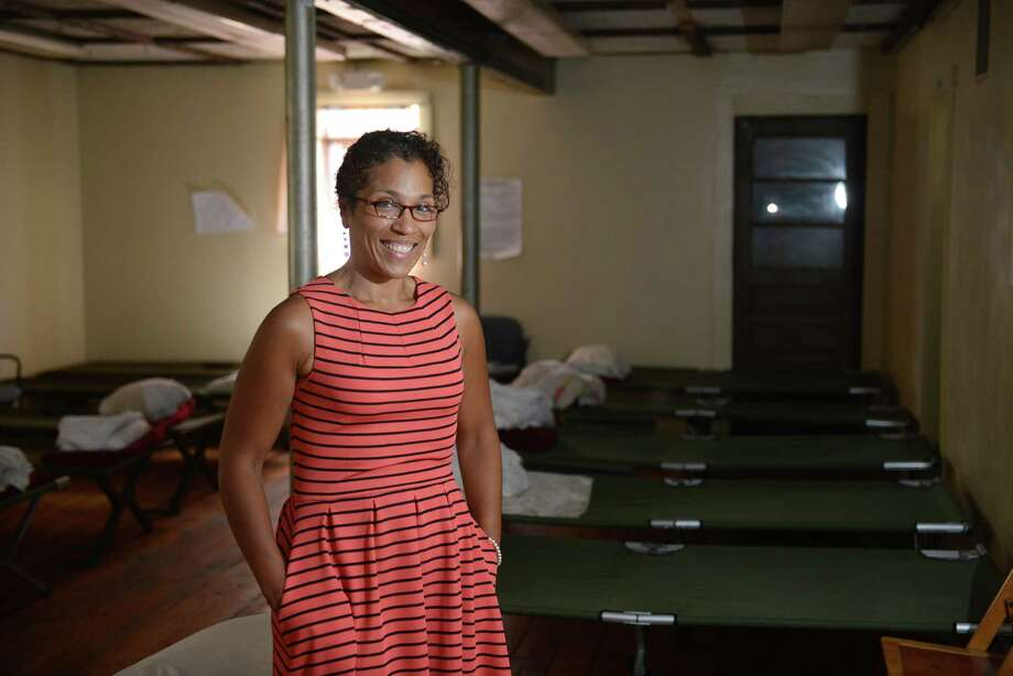 Jericho Partnership Executive Director Carrie Amos poses in the new day center for homeless men that will be opened up by the Jericho Partnership in Danbury, Conn. Wednesday, July 9, 2014.  The shelter, located at 13 Maple Ave., has 14 beds in its air-conditioned facility which will include many programs for those who need certain asssistance. Photo: Tyler Sizemore / The News-Times