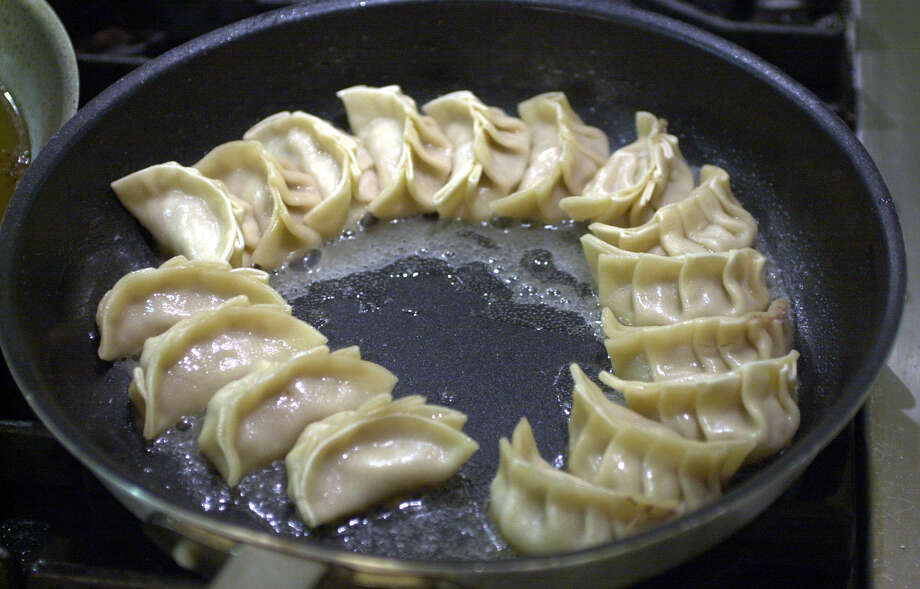 Pot-sticker dumplings will be on the menu in cookbook author Hiroko Shimbo's cooking class on Asian classics at Central Market on Tuesday. Photo: Express-News File Photo / SAN ANTONIO EXPRESS-NEWS
