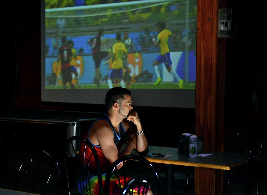 A fan who wished not to give his name, watches as Brazil loses to Germany in World Cup Soccer while watching the match on TV at Pantanal Restaurant and Churrascaria in Bridgeport, Conn. on Tuesday July 8, 2014. Brazil lost to Germany 7-1. Photo: Christian Abraham / Connecticut Post