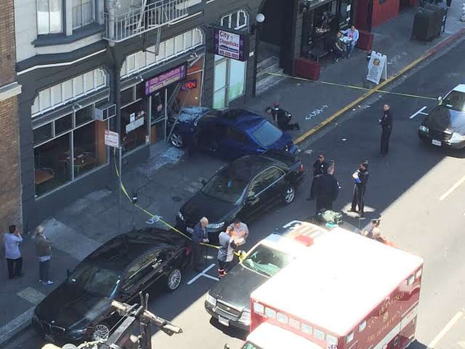 A blue Lexus crashed into the front of a restaurant near Union Square Wednesday. (Photo courtesy Wendy Crittenden)
