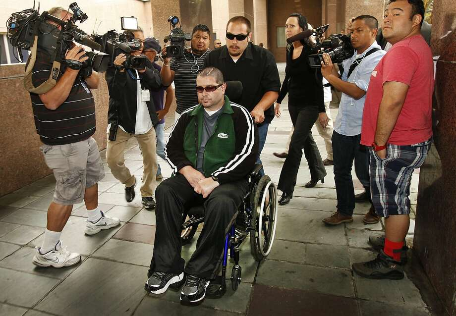 Bryan Stow, assisted by a caregiver, is nearly surrounded as he is taken into a Los Angeles courtroom on June 25. Photo: Al Seib, Associated Press