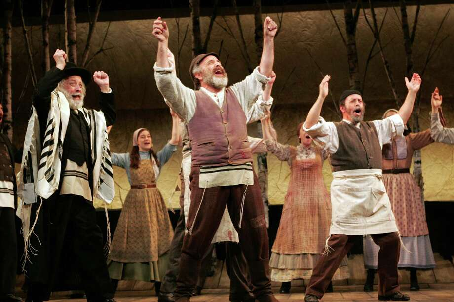 "Adam Heller (center) is playing Tevye in the Goodspeed Opera House production of ""Fiddler on the Roof"" running through Sept. 12 in east Haddam. Photo: Contributed Photo / Connecticut Post Contributed"