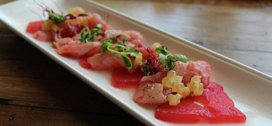 An appetizer at Starfish, Crudo comes with Cured Catch, Compressed Watermelon, Pickled Rind and Crunchy Tempura. Photo: Jennifer McInnis / San Antonio Express-News
