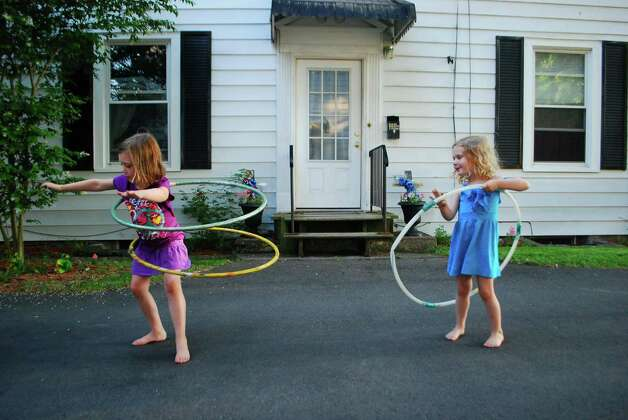 Daughters Allison, 5, and Quinn, 3, show off their hula hooping skills in this photo taken by their mom, Sarah Csiza of Albany. (Sarah Csiza)
