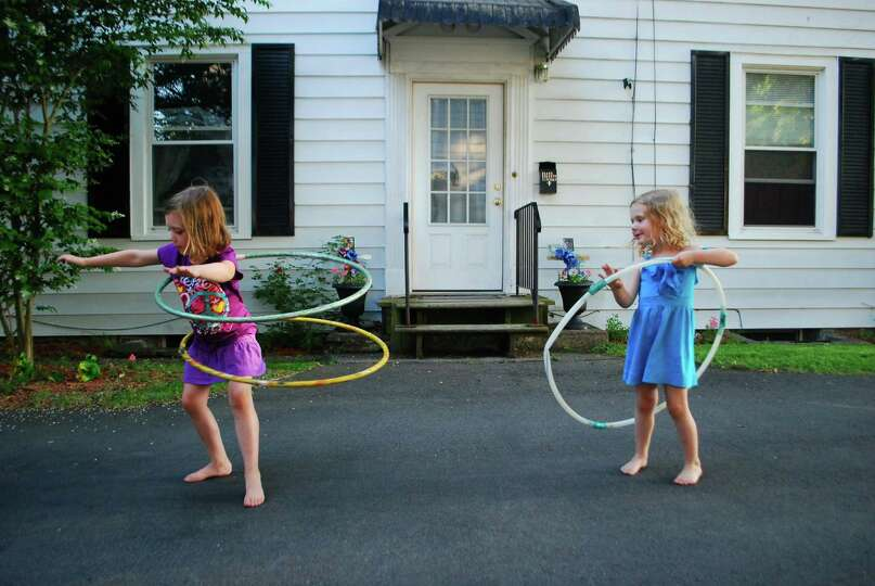 Daughters Allison, 5, and Quinn, 3, show off their hula hooping skills in this photo taken by their
