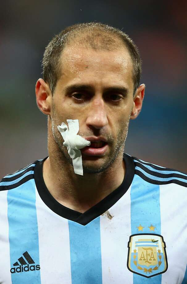Pablo Zabaleta of Argentina looks on after receiving treatment during the 2014 FIFA World Cup Brazil Semi Final match between the Netherlands and Argentina at Arena de Sao Paulo on July 9, 2014 in Sao Paulo, Brazil. Photo: Clive Rose, Getty Images