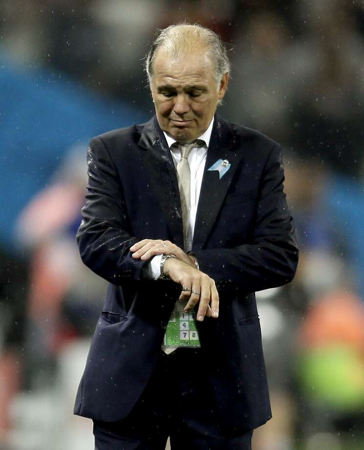 Argentina's head coach Alejandro Sabella checks his watch during the second half of the World Cup semifinal soccer match between the Netherlands and Argentina at the Itaquerao Stadium in Sao Paulo Brazil, Wednesday, July 9, 2014. Photo: Natacha Pisarenko, Associated Press