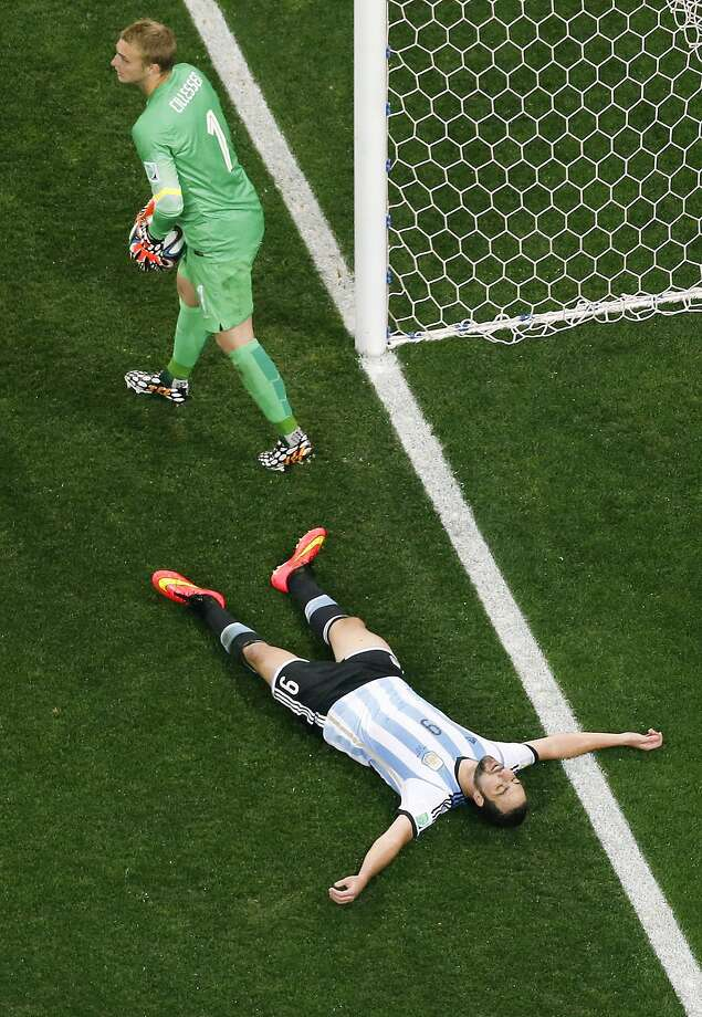 Argentina's Gonzalo Higuain lies on the pitch after missing a chance as Netherlands' goalkeeper Jasper Cillessen (1) holds the ball during the World Cup semifinal soccer match between the Netherlands and Argentina at the Itaquerao Stadium in Sao Paulo, Brazil, Wednesday, July 9, 2014.  Photo: Fabrizio Bensch, Associated Press