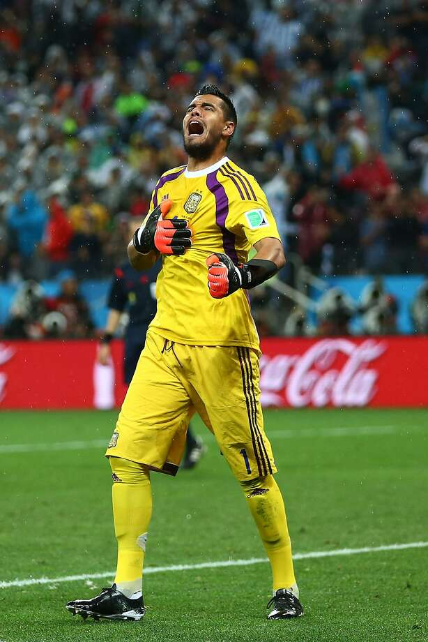 Sergio Romero of Argentina reacts after saving the penalty kick of Ron Vlaar of the Netherlands (not pictured) in a shootout during the 2014 FIFA World Cup Brazil Semi Final match between the Netherlands and Argentina at Arena de Sao Paulo on July 9, 2014 in Sao Paulo, Brazil. Photo: Ronald Martinez, Getty Images