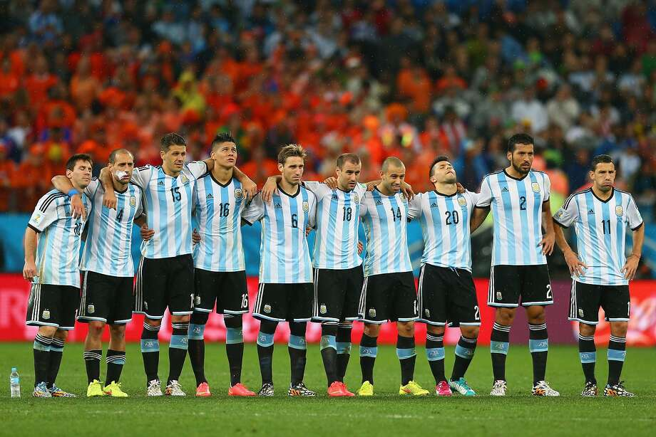 (L-R) Lionel Messi, Pablo Zabaleta, Martin Demichelis, Marcos Rojo, Lucas Biglia, Rodrigo Palacio, Javier Mascherano, Sergio Aguero, Ezequiel Garay and Maxi Rodriguez of Argentina look on during a penalty shootout during the 2014 FIFA World Cup Brazil Semi Final match between the Netherlands and Argentina at Arena de Sao Paulo on July 9, 2014 in Sao Paulo, Brazil. Photo: Ronald Martinez, Getty Images