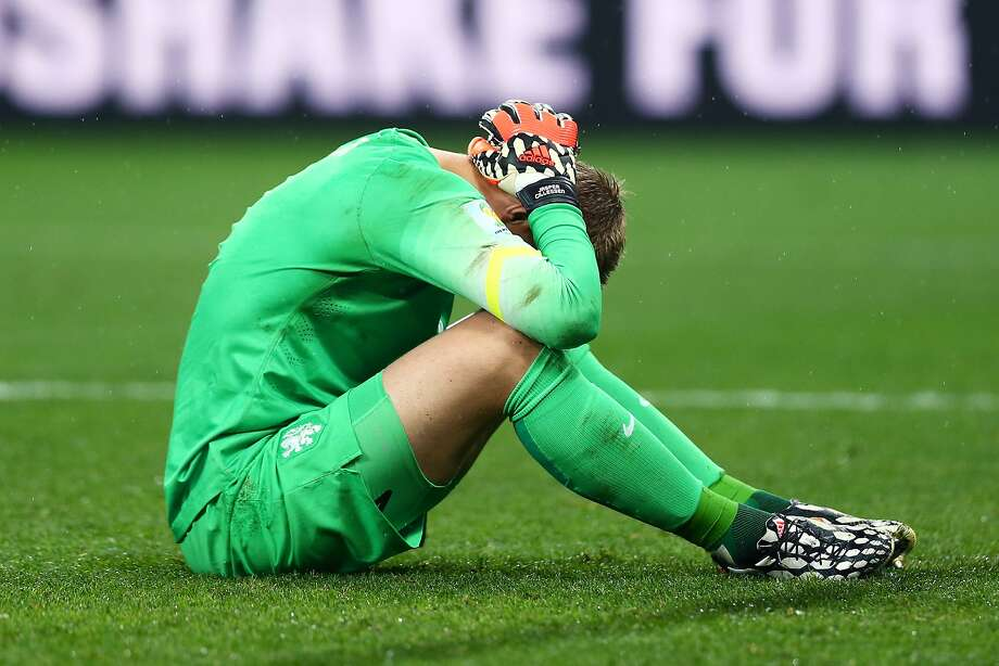 Jasper Cillessen of the Netherlands reacts after being defeated by Argentina in a penalty shootout during the 2014 FIFA World Cup Brazil Semi Final match between the Netherlands and Argentina at Arena de Sao Paulo on July 9, 2014 in Sao Paulo, Brazil. Photo: Ronald Martinez, Getty Images