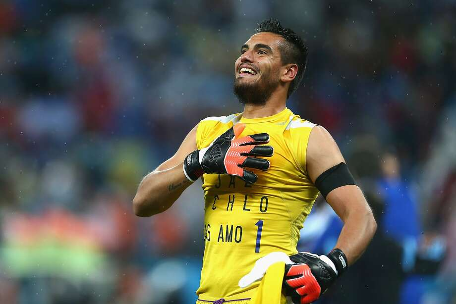 Sergio Romero of Argentina celebrates defeating the Netherlands in a shootout during the 2014 FIFA World Cup Brazil Semi Final match between the Netherlands and Argentina at Arena de Sao Paulo on July 9, 2014 in Sao Paulo, Brazil.  Photo: Ronald Martinez, Getty Images