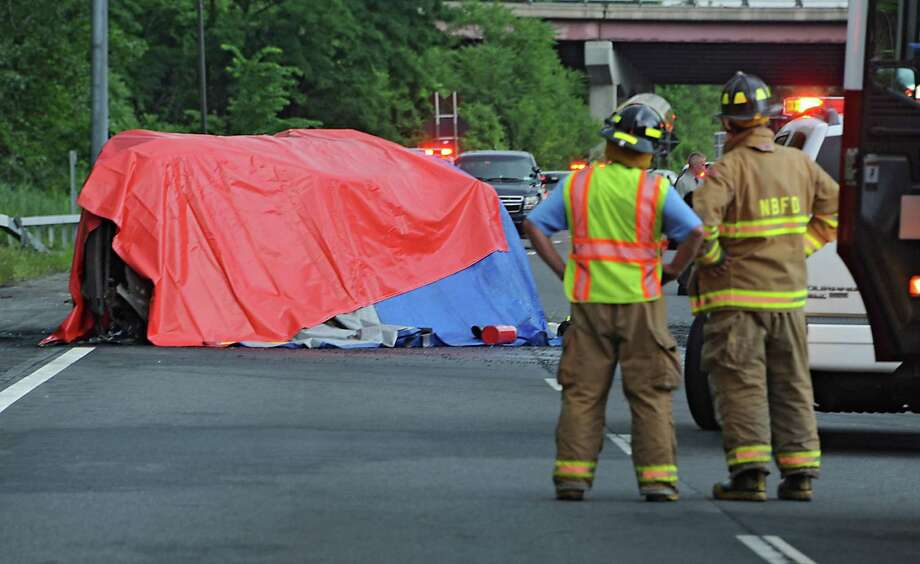 Tarp drapes a vehicle involved in a crash on the Northway southbound near the Crossgates Mall ramp, which caused the highway to be closed in that area on Wednesday, July 9, 2014 in Guilderland, N.Y. (Lori Van Buren / Times Union) Photo: Lori Van Buren