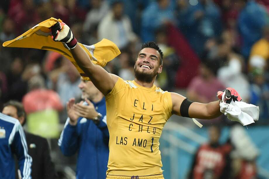 Argentina goalkeeper Sergio Romero, who saved two penalty kicks, celebrates the semifinal win. Photo: Damien Meyer, AFP/Getty Images