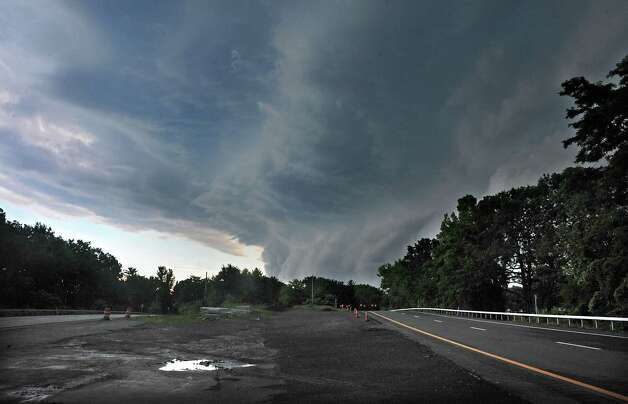 Storm clouds are seen from I-87 near Rt. 20 moving in from the west on Wednesday, July 9, 2014 in Guilderland, N.Y. The rain clouds caused a downpour minutes after this photo was taken. (Lori Van Buren / Times Union) Photo: Lori Van Buren