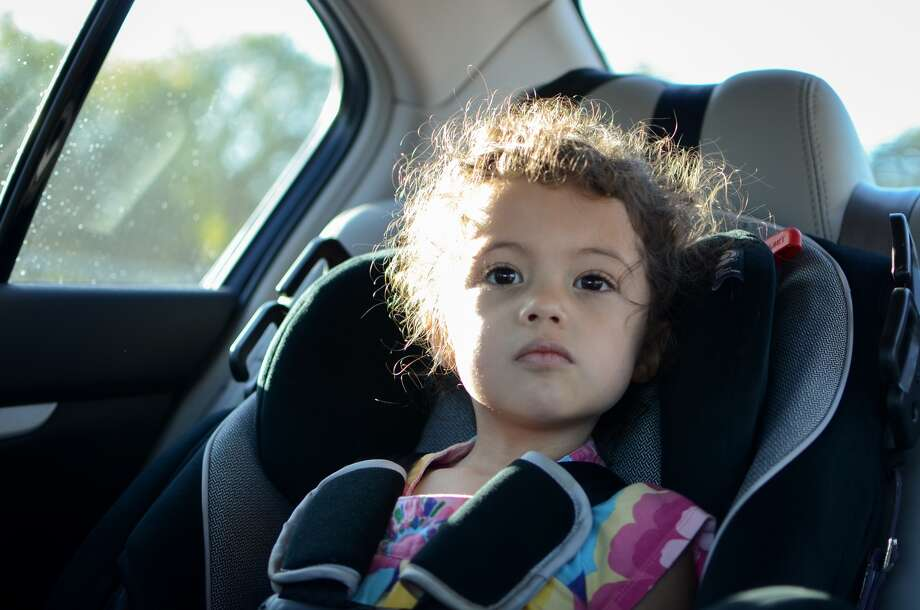 3. Booster seat.Children must be buckled into a booster seat until the age of eight or until they grow to be 4'9''. The previous law required children to be buckled in until the age six or until they reached 60 pounds. Photo: Kevin Reid, Getty Images