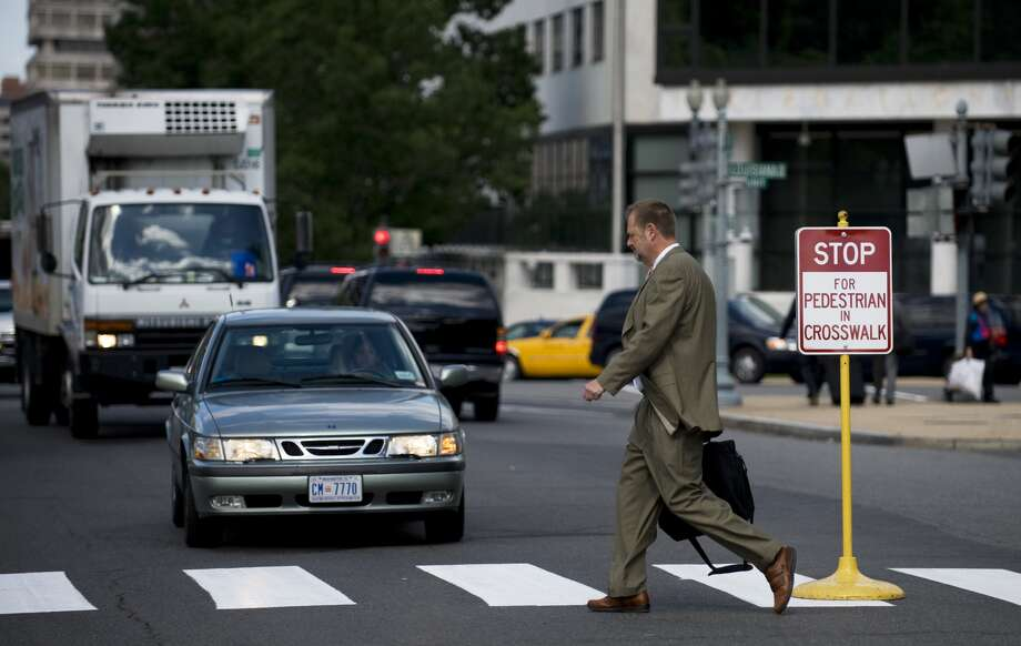 5. Yield at all crosswalks.California law requires vehicles to yield the right-of-way to all pedestrians in marked, unmarked and mid-road crosswalks. Don't pretend as if you didn't see them. VC 21950. Photo: Bill Clark, Getty Images