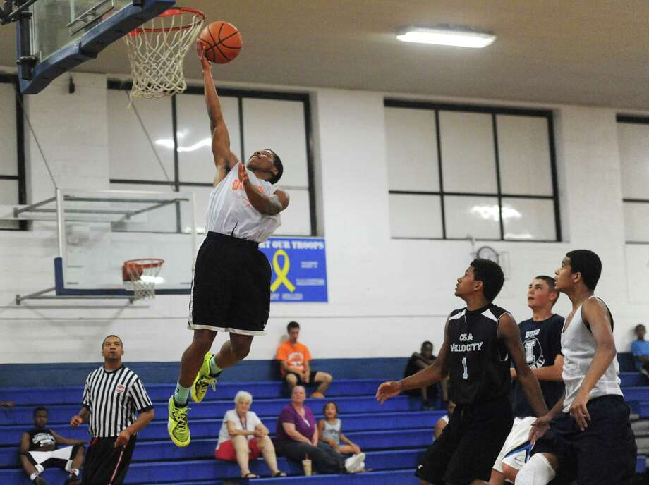 Danbury's Tysheen McCrea makes a layup in Danbury's 53-44 win over Immaculate in the high school basketball suumer league game at the Danbury War Memorial in Danbury, Conn. Wednesday, July 9, 2014. Photo: Tyler Sizemore / The News-Times