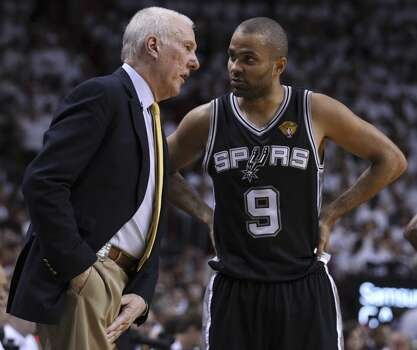 Spurs Head Coach Gregg Popovich talks with Spurs' Tony Parker (09) in Game 4 of the 2014 NBA Finals at the American Airlines Arena in Miami on Thursday, June 12, 2014. (Kin Man Hui/San Antonio Express-News) Photo: Kin Man Hui, San Antonio Express-News