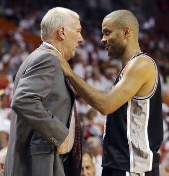San Antonio Spurs head coach Gregg Popovich talks with Tony Parker during Game 3 of the NBA Finals against the Miami Heat Tuesday June 10, 2014 at American Airlines Arena in Miami, Fla. Photo: Edward A. Ornelas, San Antonio Express-News